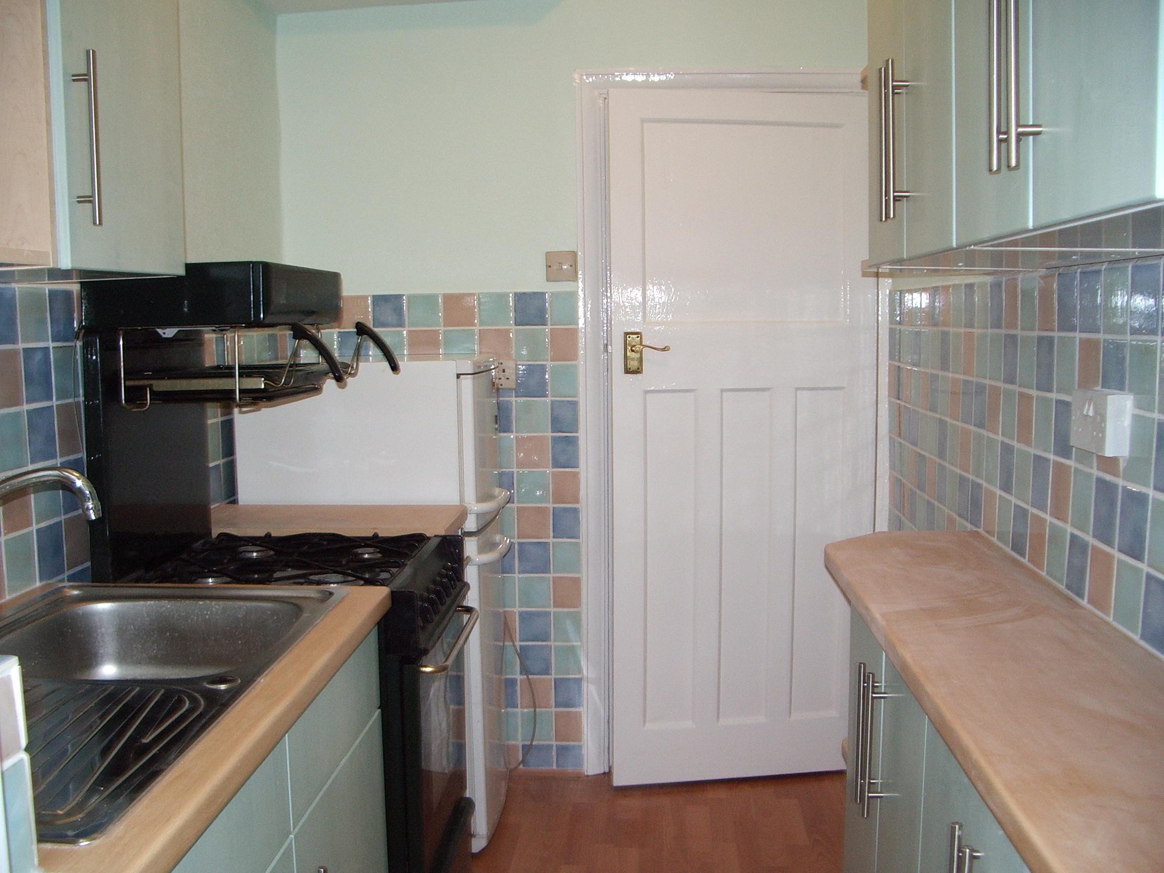 Mike walton property maintenance plumbing kitchen design for Beech effect kitchen units